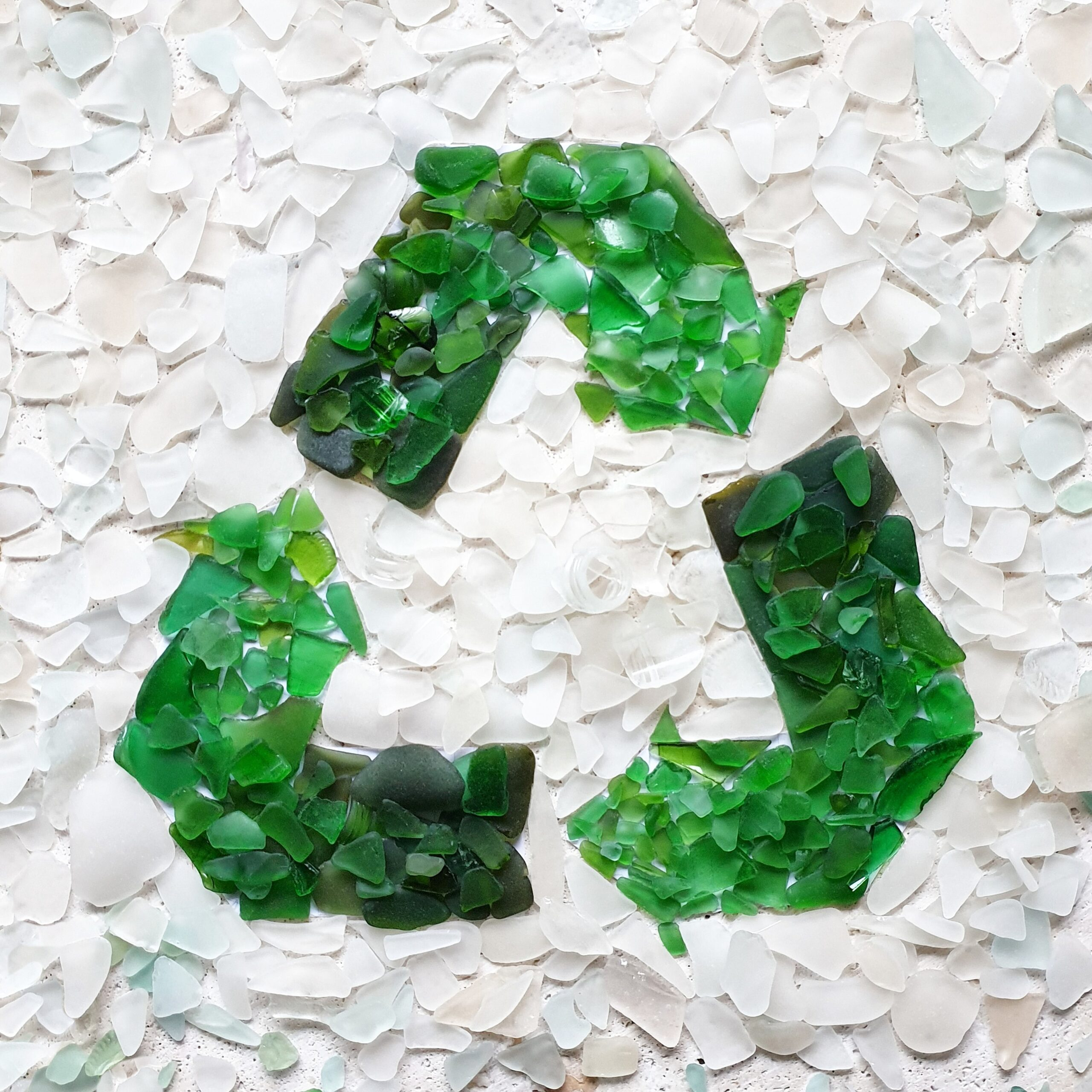 recycle-symbol-made-from-broken-glass-collected-fr-YQ3MYDZ