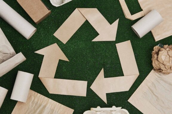 recycling-symbol-made-of-paper-357BPUZ