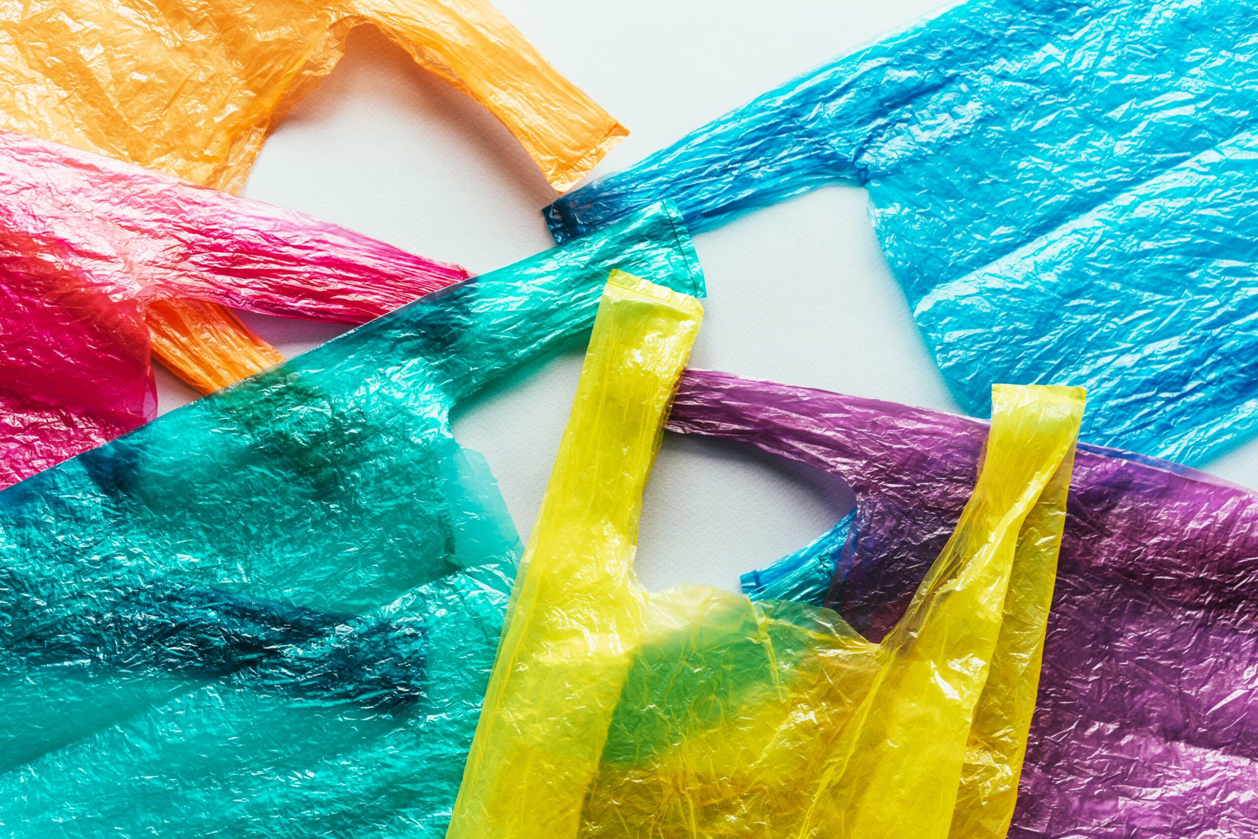 Several bright colored disposable plastic bags